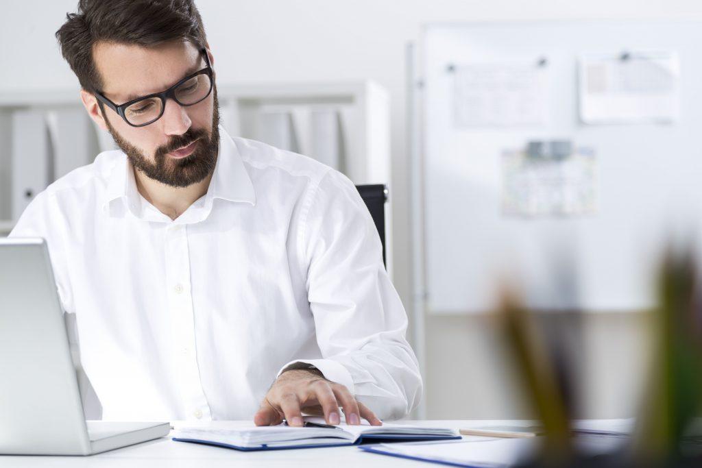 Man with beard looking at radish logo